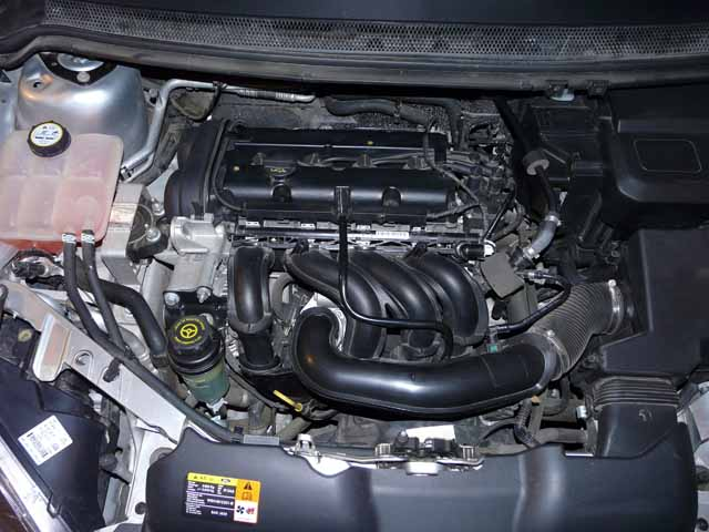 Где находиться номер двигателя на форд фокус